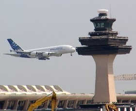 Federal Aviation Administration (FAA) tower in the distance at Dulles International Airport