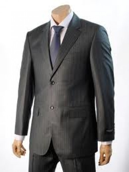 It is a good idea when speaking to leave you coat undone.  It's a bit like opening folded arms and taking off dark glasses. You then appear more relaxed, more accommodating.