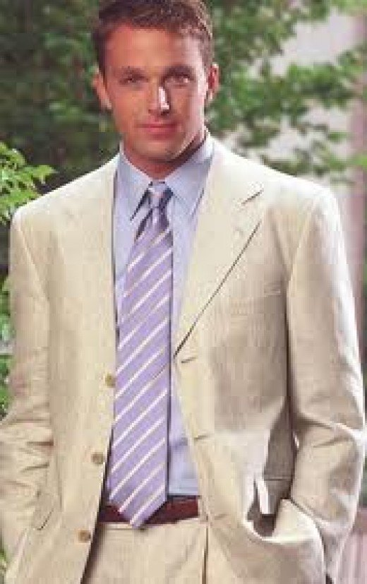 Here is an example of a well-dressed man.   Note no clashing colors, modest tie which is just the right length.