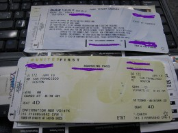 Ticket agents at the airport issue boarding passes.