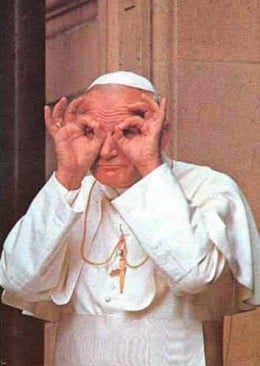 The pope sees the truth with the aid of his new 'hand made' spectacles.
