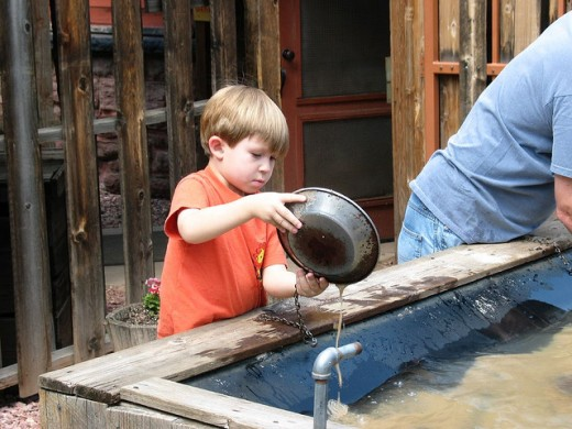 After his father falls ill to dysentery, Little Tim takes his father's place to pan for gold, which is perfectly legal since President Ron Paul eliminated child labor laws.