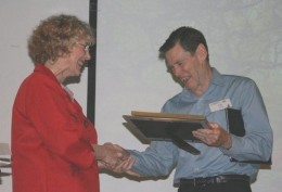Yours truly being loaded up with plaques for winning a short story writing competition.  Note how presenter gives you full attention.