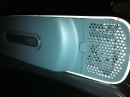 The hard drive is located along the left edge of the Xbox 360. A damaged or defective hard drive could result in a red light error.