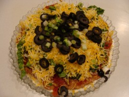 Add the additional toppings like the black olives and green onion.