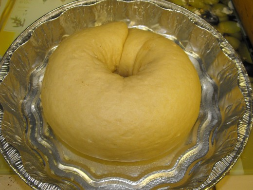 Create a ring in your cake pan, seam side down