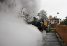 Didcot Railway Centre 3738 departs in a cloud of steam.
