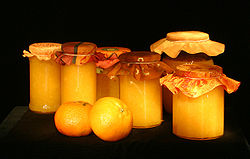 Sweet homemade fruit marmalade packed in a jar.  Besides the fruit itself, crushed apple adds density and flavor.