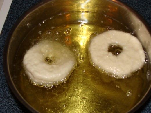 Carefully place the donuts in the hot oil and watch closely.