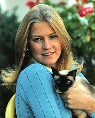 Former president Gerald Ford's daughter, Susan, holding the family's Siamese cat Shan.