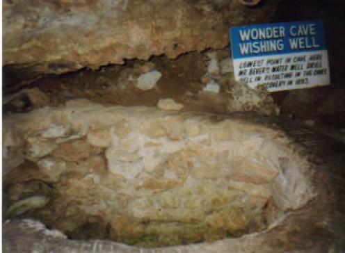 Wishing well in Wonder Cave in Texas. Throwing coins in pools is supposed to be good luck but it's not good for the caves.