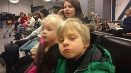 This is me and my children waiting at the Helsinki airport. I'm talking to my mum on the phone.