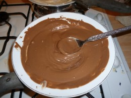 Melt the chocolate over a simmering pan of water or use the microwave but stir every 10 seconds to ensure that it doesn't burn.