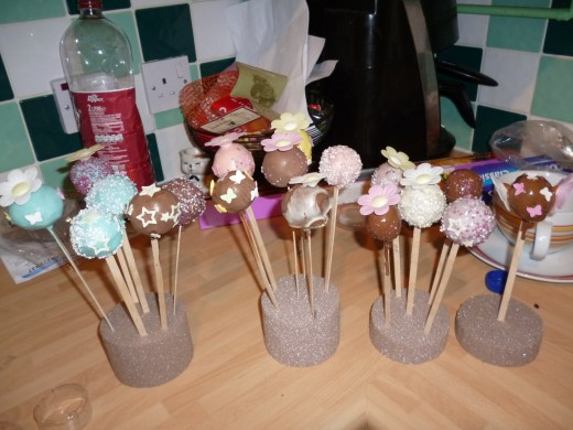A finished set of cake pops displayed on Styrofoam. Not bad for a first attempt
