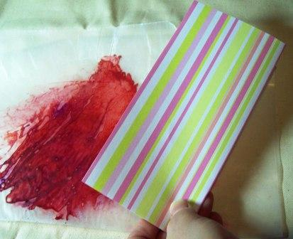 Take some scrapbooking paper or other nice paper, and fold in half.  Cut out a heart shape.