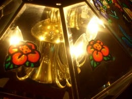 These flowers dress up the dining room table light.