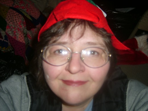 This is a picture of me in my elf's hat, Christmas 2009. It was very late, no make-up, but a song was still in my heart.