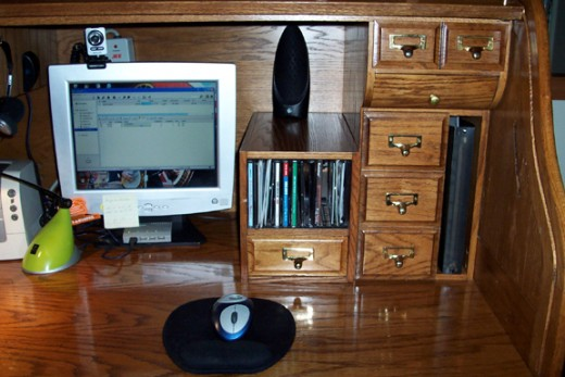 The CD rack/drawer fit nicely on top of the desk beside the upper drawers on the right side. The top of the module gives me a place to set my inbox.