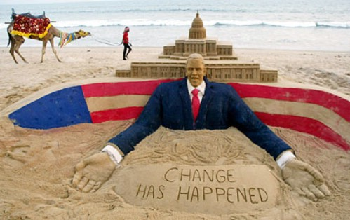 """A sand sculpture welcoming President Barack Obama to the white house showing """"Change has happened""""."""