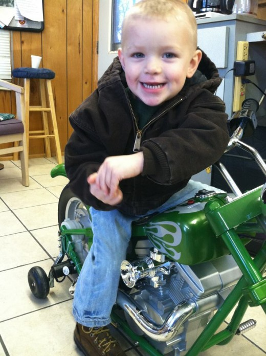 My grandson Maddy on his new elctric motorcycle.