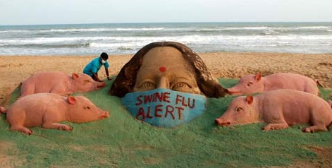 """Outbreak of swine flu in India and Mr. Patnaik sculpted this showing a lady with a mask clearly written """"swine flu alert"""" on it."""