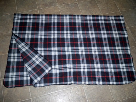 Fold blanket in half.  You will be cutting in the center of the fold.