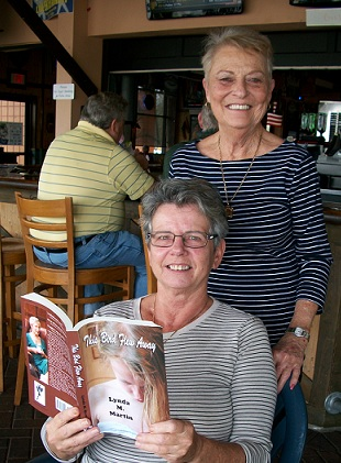 Me, last year with my novel and my friend Sharon.