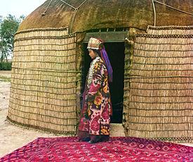 A woman in front of a yurt in Turkestan, 1913