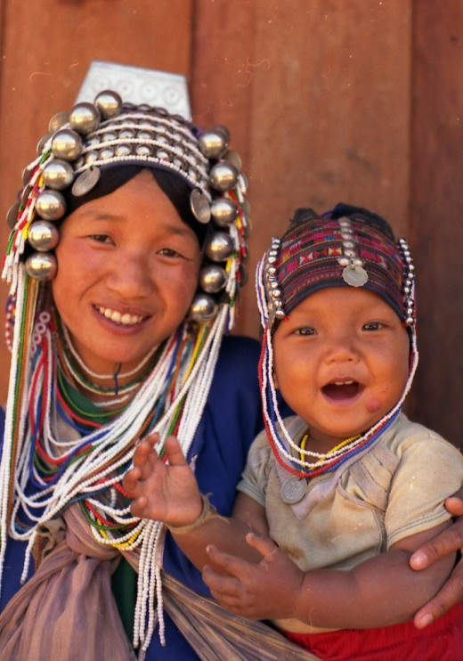 Akha hill tribe woman and child in village, North Thailand