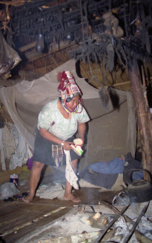 Akha hill tribe woman at home, North Thailand