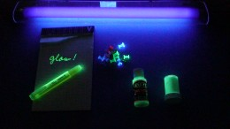 When the black light is turned on, it glows a dark purple and the fluoreschent objects glow.