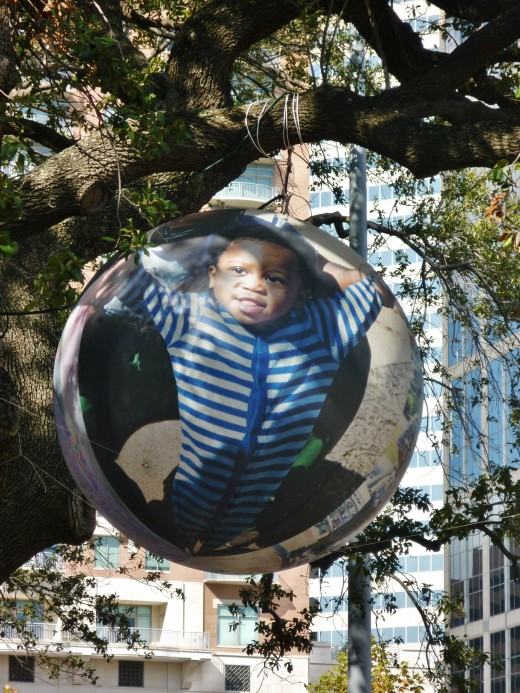 """Seasonal art exhibit at Discovery Green Park by artist David Graeve with the title """"Through The Eyes of a Child"""""""