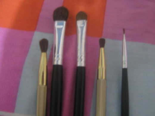 These are the brushes I use for my smoky eye look. (From left-right:) The first two brushes are the ones I use to blend colors and shades; next, the applicator brush; the fourth, smudge brush; and lastly, the eyeliner brush.