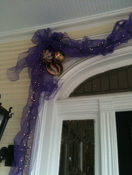 Purple art mesh layered over a strand of Mardi Gras lights