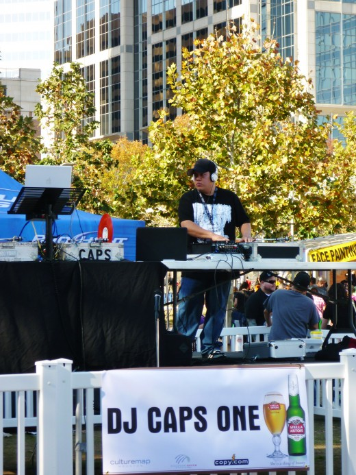 A DJ providing music for the crowd at Discovery Green during the ice sculpting contest.