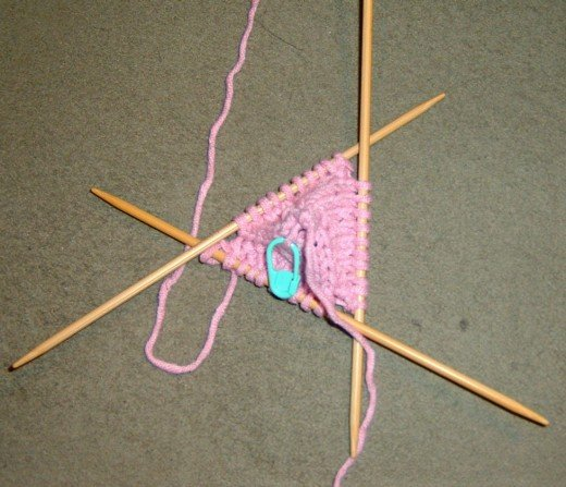 Start with an 1.5 inch 3 stitch I cord, and then make an increase round and move to double pointed needles.  This is going to be the top.