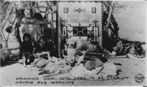 Spinning wool into yarn to be used in Navajo rug weaving. Southern Navajo Agency, 1933
