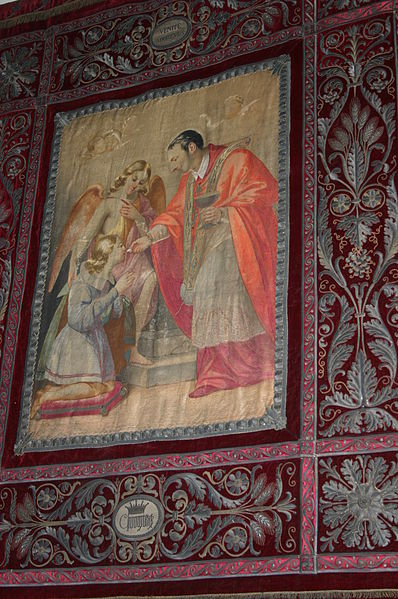 """""""Charles Borromeo gives the holy communion to Aloysius Gonzaga"""". Red velvet tapestry, embroidered in gold (19th century), in Saint Charles' chapel in the church of San Carlo al Corso church in Milan. Picture by Giovanni Dall'Orto, June 22 2007."""