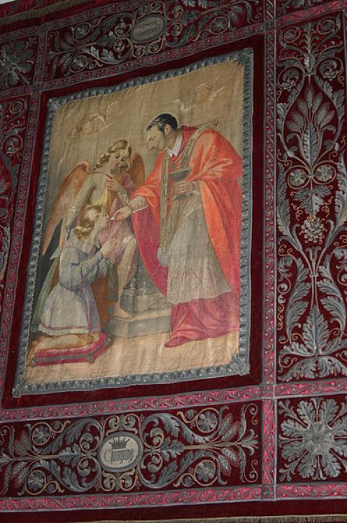 """Charles Borromeo gives the holy communion to Aloysius Gonzaga"". Red velvet tapestry, embroidered in gold (19th century), in Saint Charles' chapel in the church of San Carlo al Corso church in Milan. Picture by Giovanni Dall'Orto, June 22 2007."