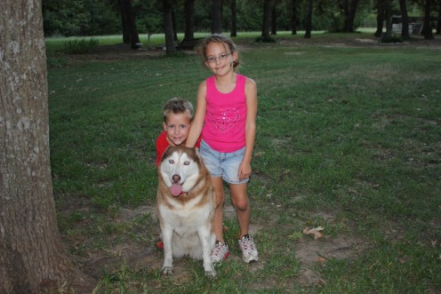 Two of our grandchildren and out Siberian husky, Meisha.