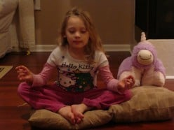 Relaxed pose, dim lighting and comfortable clothing all aid in making mediation easier for children.  You can even have a friend meditate with you!