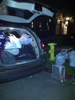 One of our cars loaded with bags for clothing for distribution.
