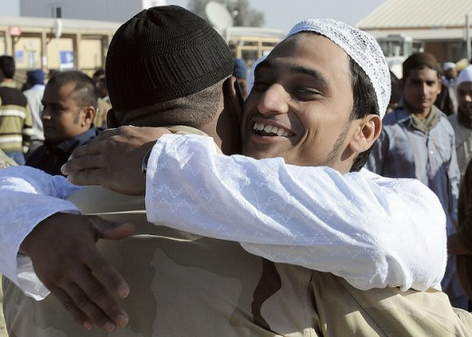 Aamir, a Muslim worshipper, hugs U.S. Navy Petty Officer 3rd Class Phrshin Jackson, assigned to the NATO Role 3 Multinational Medical Unit, after the prayer service of Eid al-Adha at Kandahar Airfield, Afghanistan, Nov. 16.