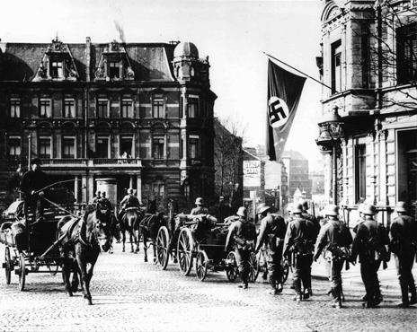 German soldiers enter Aachen, Germany on the border with Belgium during the remilitarization of the Rhineland.
