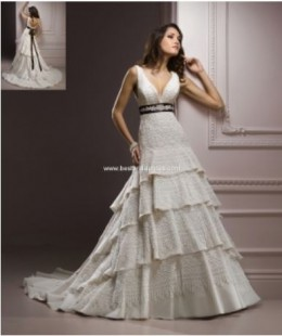 Cascading tiers of Chic Organza, Crystal Tulle and vintage lace create a romantic tiered A-line skirt. The plunging V-neckline is completed by detachable satin ribbon remarkably adorned with an array of beading featuring Swarovski crystals.
