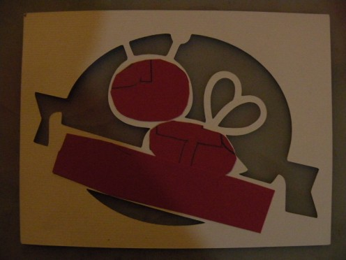 Handcut shapes adhered to back of cutout