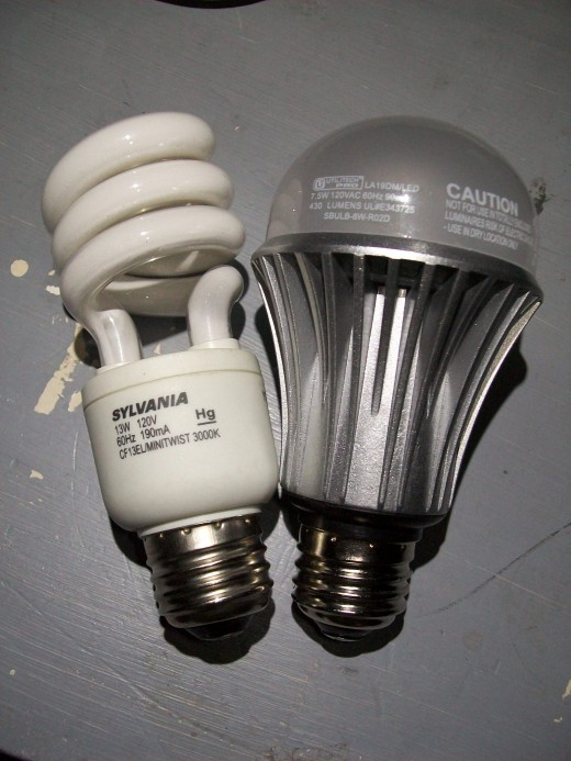 A size comparison between a 13 watt CFL made by Sylvania and a 7.5 Watt LED made by Utilitech