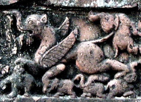 An imagenry winged animal, with curved beaks, a lot of teeth, tramples elephants , yet strangles another elephant with its tail! Size of this animal will be at least five times that of an elephant ! !  JorBangla,Dt - Bishnupur.
