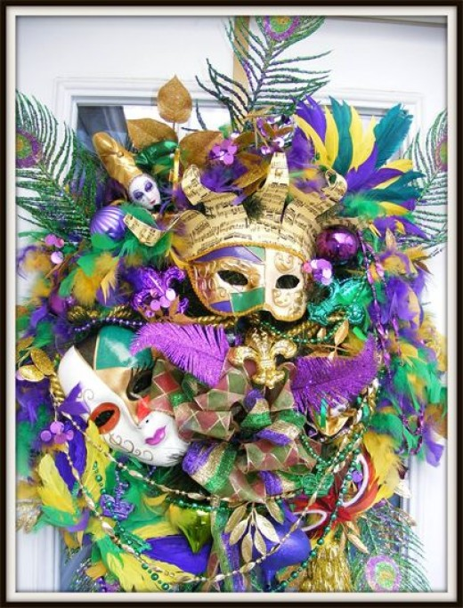 This wreath has too much going on for my taste.  If you want to have the chaotic style of Mardi Gras, here's a great example.