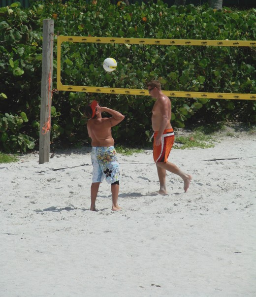 Play a round of beach volleyball.